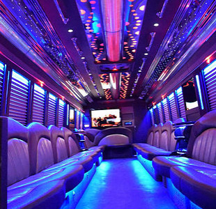 Interior shot of WICKED party bus designed for long trips with restroom