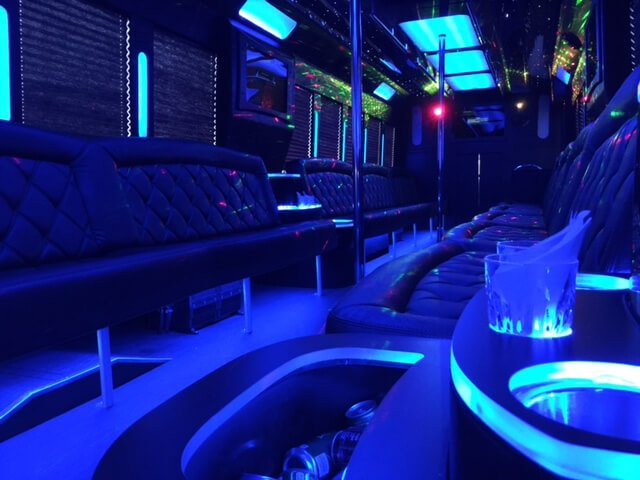 The ACES party bus features dual dance poles
