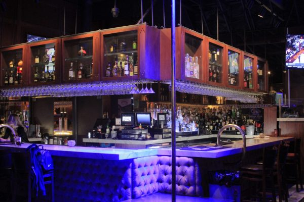 Bar and main stage with stripper pole inside Scores Las Vegas