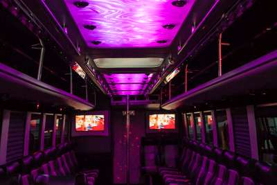 Plush interior of BIG TIME 40 passenger white party bus